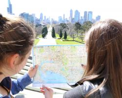 Girls using Map to Orientate and Navigate through Melbourne on Camp